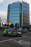 A police car stopping traffic at Old Street roundabout, London, United Kingdom. (photo by Andrew Aitchison / In pictures via Getty Images)