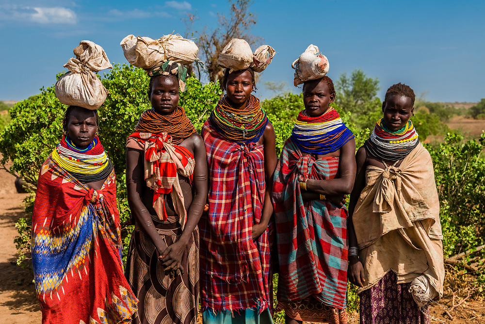 Nyangatom tribe women wearing layers of beaded necklaces as decoration. Omo Valley, Ethiopia.