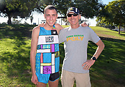 Dec 8, 2018; Balboa Park, CA, USA; Will Frankenfeld aka William Frankenfeld of Long Beach Poly (Calif.), left, poses with coach Mike Fillipow after placing 14th in the boys race in 15:52.4 during the 40th Foot Locker cross country championships at Morley Field.