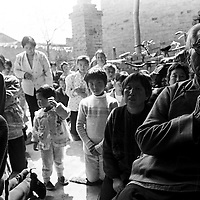 LIUJIAZHUANG VILLAGE, 15APRIL 2001:underground catholics pray outside a factory building during the Easter mass.. China cut relations with the vatican in the early fifites and since then, established a Patriotic catholic Church that's controlled by Chinese authorities.<br />Catholics who refused to give up their ties with the Vatican, started worshipping in underground churches and consequently were persecuted for a long time. Since the late nineties though, relations with the vatican informally started to improve. Although China still has no diplomatic relations, many representatives from official churches met the pope John Paull II secretely . Since the pope's death on Saturday, thousands of catholics commemorate John Paull II  in special masses throughout China.