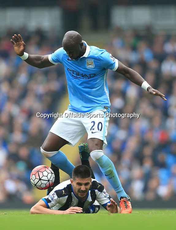 3rd October 2015 - Barclays Premier League - Manchester City v Newcastle United - Eliaquim Mangala of Man City tackles Aleksandar Mitrovic of Newcastle - Photo: Simon Stacpoole / Offside.