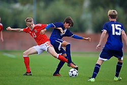 NEWPORT, WALES - Sunday, September 24, 2017: Wales' Eli King and Gibraltar's Kieron Baglietto during an Under-16 International friendly match between Wales and Gibraltar at the Newport Stadium. (Pic by David Rawcliffe/Propaganda)