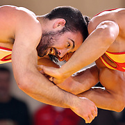 Kellen Russell, USA, (blue) in action against Mehdi Taghavi Kermani, Iran, as wrestlers from USA, Iran and Russia compete at Grand Central Terminal as part of the Beat the Streets Gala. Billed ?The Rumble On The Rails,? the international wrestling event showcased competition as part of World Wrestling Month. Vanderbilt Hall, Grand Central Station, Manhattan,New York. USA. 15th May 2013. Photo Tim Clayton