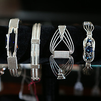 The three ladies make a variety of different styles of braclets, earrings and rings.