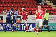 Nottingham Forest midfielder João Carvalho (10) gets in-between Charlton Athletic forward Lyle Taylor (9) and Nottingham Forest forward Sammy Ameobi (19) who committed a foul on Charlton Athletic defender Adedeji Oshilaja (4) during the EFL Sky Bet Championship match between Charlton Athletic and Nottingham Forest at The Valley, London, England on 21 August 2019.