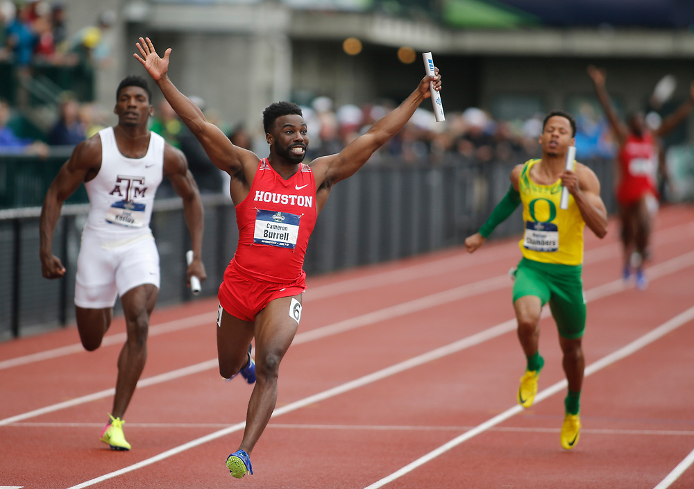 Houston's Cameron Burrell raises his arms in victory in after crossing the finish line in the men's 4x100 meterrs relay on the third day of the NCAA outdoor college track and field championships in Eugene, Ore., Friday, June 9, 2017. Houston's wining time was 38.34 seconds (AP Photo/Timothy J. Gonzalez)