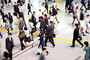 overhead view of commuters during rush hour Tokyo Japan