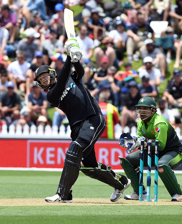 New Zealand's Martin Guptill hits a six in front of Pakistan's Sarfraz Ahmed in the first one day cricket international at the Basin Reserve, Wellington, New Zealand, Saturday, January 06, 2018. Credit:SNPA / Ross Setford  **NO ARCHIVING**