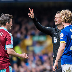 referee Mark Clattenburg makes a point or two to Burnley midfielder Joey Barton (19) in the Premier League match between Everton and Burnley<br /> (c) John Baguley | SportPix.org.uk