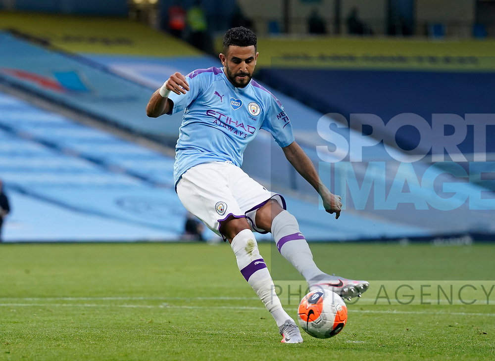 Riyad Marhez of Manchester City scores the third goal from the penalty spot during the Premier League match at the Etihad Stadium, Manchester. Picture date: 22nd February 2020. Picture credit should read: Andrew Yates/Sportimage