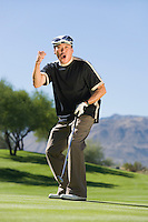 Excited Man on Putting Green