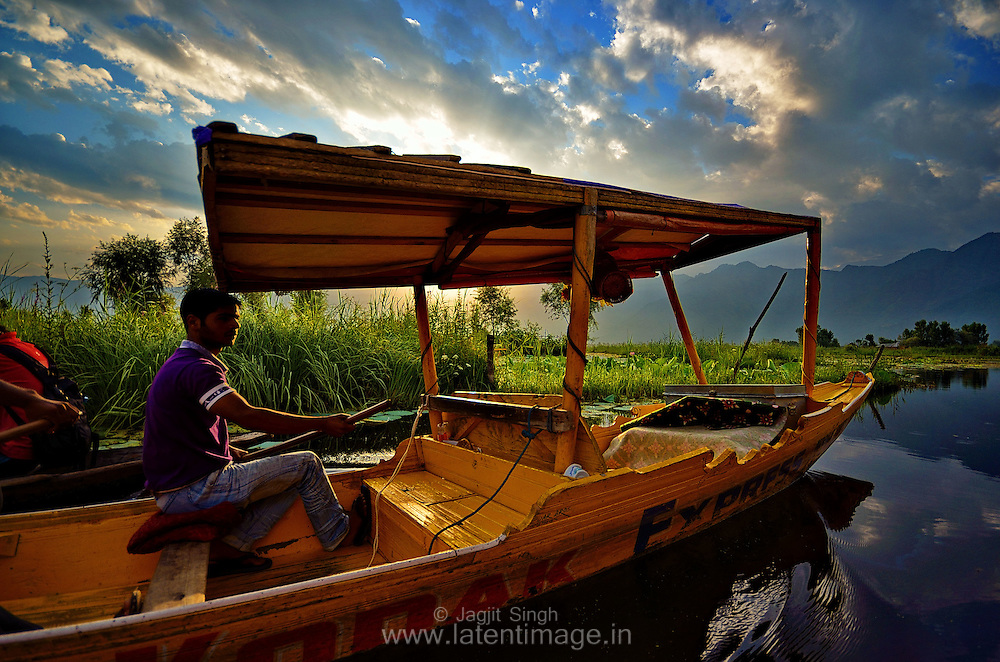 'Shikara', as it is called in Kashmir, is a wooden house boat used for ferrying visitors across the Dal Lake, Srinagar, India.