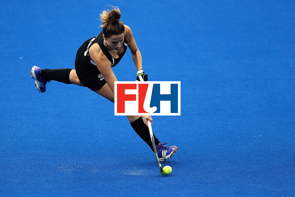 RIO DE JANEIRO, BRAZIL - AUGUST 12:  Pippa Hayward #26 of New Zealand passes against Netherlands during a Women's Preliminary Pool A match on Day 7 of the Rio 2016 Olympic Games at the Olympic Hockey Centre on August 12, 2016 in Rio de Janeiro, Brazil.  (Photo by Sean M. Haffey/Getty Images)
