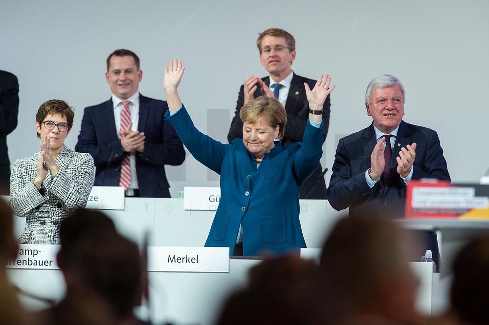 07 DEC 2018, HAMBURG/GERMANY:<br /> Angela Merkel, CDU, Bundeskanzlerin, nach Ihrer letzten Rede als Parteivorsitzende, unten links: Annegret Kramp-Karrenbauer, CDU Generalsekretaerin, unten rechts: Volker Bouvier, CDU, Ministerpraesident Hessen, hinten v.L.n.R.: Dr. Roland Heintze, CDU Landesvorsitzender Hamburg, Daniel Guenther, CDU, Ministerpraesident Schleswig-Holstein, CDU Bundesparteitag, Messe Hamburg<br /> IMAGE: 20181207-01-087<br /> KEYWORDS: party congress, Appluas, applaudiren, klatschen, Jubel, Daniel Günther