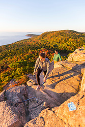 "Hikers make their way up ""The Beehive"" in fall in Maine's Acadia National Park."