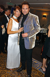 Footballer JASON CUNDY and his wife LIZ at a ball in aid of Cystic Fibrosis Trust held at the London Marriott, Grosvenor Square, London on 28th October 2005.<br /><br />NON EXCLUSIVE - WORLD RIGHTS