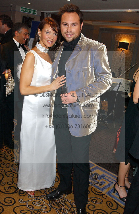 Footballer JASON CUNDY and his wife LIZ at a ball in aid of Cystic Fibrosis Trust held at the London Marriott, Grosvenor Square, London on 28th October 2005.<br />