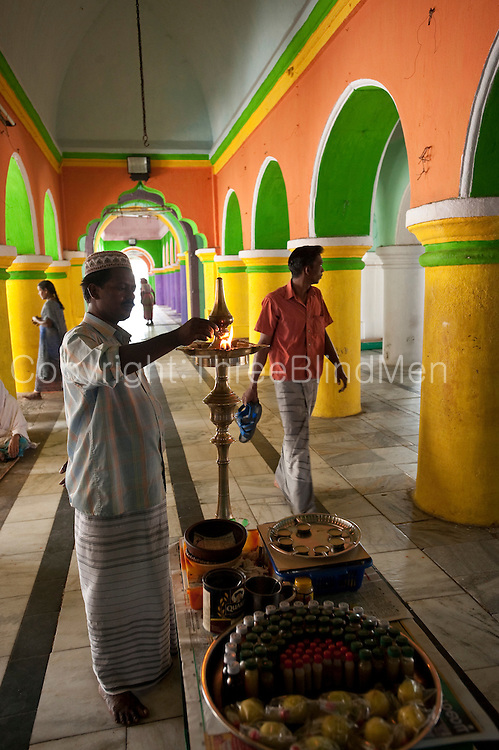 Lamp attendant. Dargah shrine.
