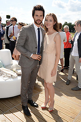 TOM RILEY and ? at the Audi Polo Challenge 2013 at Coworth Park Polo Club, Berkshire on 3rd August 2013.