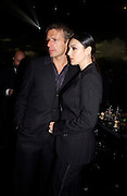 MONICA BELLUCI and actor LAMBERT WILSON, Party to celebrate 100 years of the Santosd de Cartier watch. Le Bourget airport. Paris. 7 April 2004. SUPPLIED FOR ONE-TIME USE ONLY> DO NOT ARCHIVE. © Copyright Photograph by Dafydd Jones 66 Stockwell Park Rd. London SW9 0DA Tel 020 7733 0108 www.dafjones.com