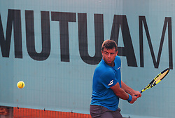 May 8, 2018 - Madrid, Spain - Ryan Harrison of USA plays a backhand to Guillermo Garcia Lopez of Spain in the 2nd Round match during day four of the Mutua Madrid Open tennis tournament at the Caja Magica. (Credit Image: © Manu Reino/SOPA Images via ZUMA Wire)
