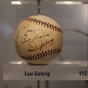 A baseball signed by Lou Gehrig sits along side baseballs signed by Yankees players past and present inside the Yankee Museum at Yankee Stadium, The Bronx, New York.  Photo Tim Clayton