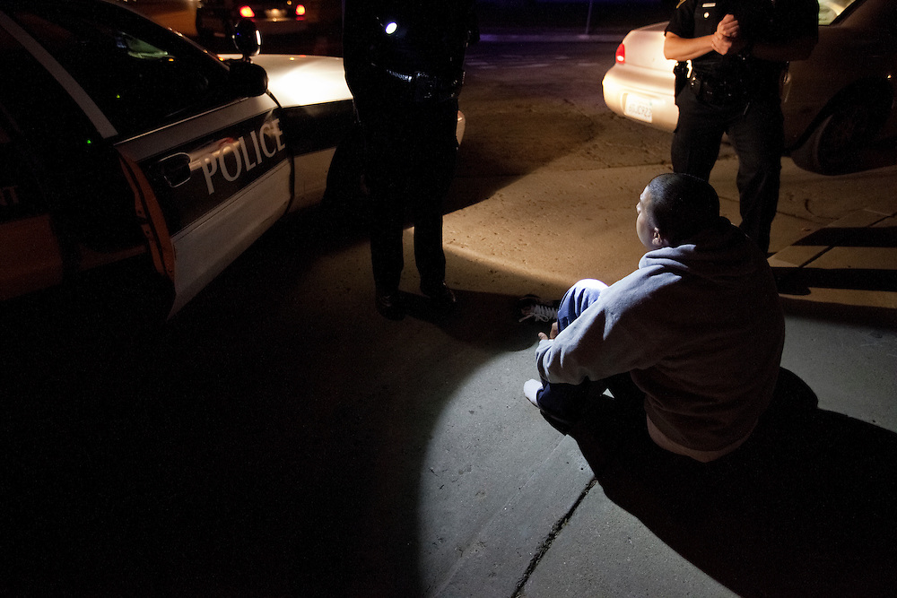 A gang member is questioned during a traffic stop. The unidentified man was found to be part of the Oxnard city gang injunction. Dec. 10, 2011. Oxnard, Calif. (Photo by Gabriel Romero ©2011)