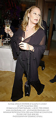 Actress URSULA ANDRESS at a party in London on 27th November 2002.