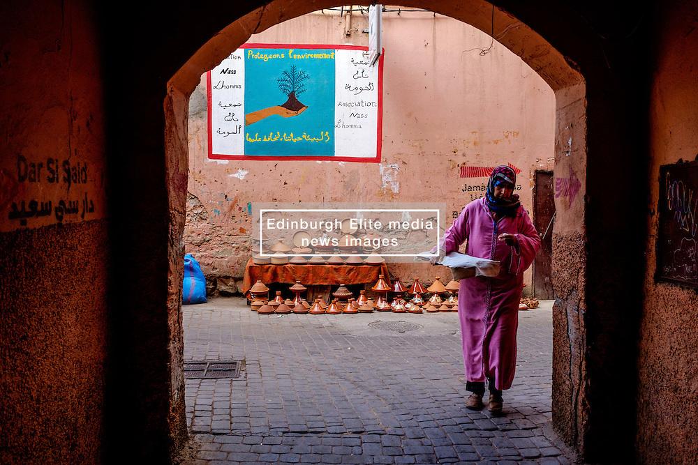 A Moroccan woman in traditional dress walks  through the Medina in Marrakech, Morocco, North Africa<br /> <br /> <br /> (c) Andrew Wilson | Edinburgh Elite media