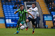 AFC Wimbledon midfielder Dannie Bulman (4)  battles with Bolton Wanderers forward, on loan from Cardiff City, Adam Le Fondre (45)  during the EFL Sky Bet League 1 match between Bolton Wanderers and AFC Wimbledon at the Macron Stadium, Bolton, England on 4 March 2017. Photo by Simon Davies.