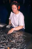 Women working with spoon blanks in a cutlery factory in Sheffield ....