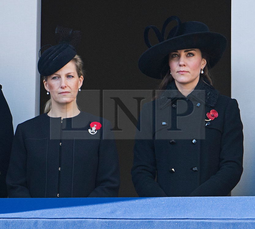 © London News Pictures. 11/11/2012. London, UK. Sophie, Countess of Wessex (left) and Catherine Duchess of Cornwall (right) look on during the Remembrance Day Ceremony at the Cenotaph on November 13, 2011 in London, United Kingdom. Politicians and Royalty joined the rest of the county in honouring the war dead by gathering at the iconic memorial to lay wreaths and observe two minutes silence. Photo Credit: Ben Cawthra/LNP