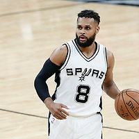 03 May 2017: San Antonio Spurs guard Patty Mills (8) brings the ball up court during the San Antonio Spurs 121-96 victory over the Houston Rockets, in game 2 of the Western Conference Semi Finals, at the AT&T Center, San Antonio, Texas, USA.