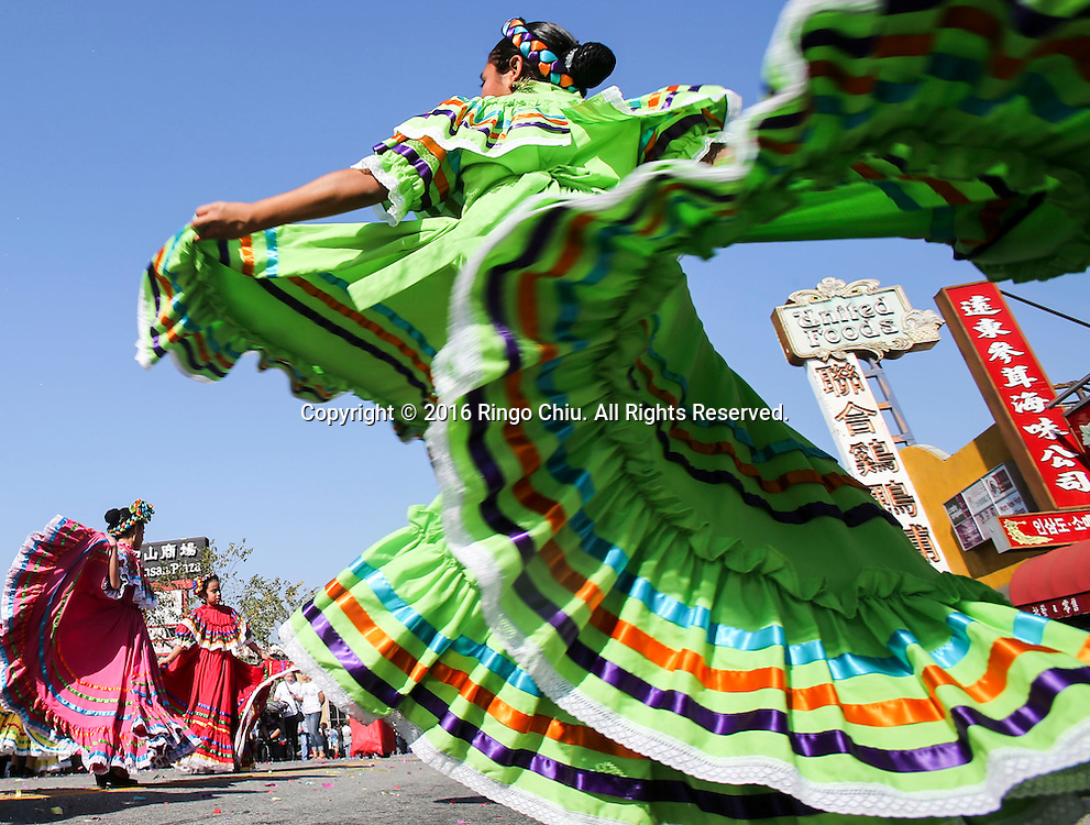 Dancers perform during the 117th annual Chinese New Year &quot;Golden Dragon Parade&quot; in the streets of Chinatown in Los Angeles, Saturday Feb. 13, 2016. (Photo by Ringo Chiu/PHOTOFORMULA.com)<br /> <br /> Usage Notes: This content is intended for editorial use only. For other uses, additional clearances may be required.