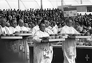 During the celebration of Mass at the Phoenix Park, clergy carry bowls containing the Hosts to be distributed to the congregation.<br />