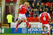 Rotherham United forward Michael Smith (24) loses out to Bradford City midfielder Romain Vincelot (6) in the air  during the EFL Sky Bet League 1 match between Rotherham United and Bradford City at the AESSEAL New York Stadium, Rotherham, England on 23 January 2018. Photo by Simon Davies.