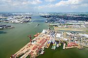 Nederland, Zuid-Holland, Rotterdam, 10-06-2015; Nieuwe Maas ter hoogte van Schiedam, met  Wiltonhaven en werf en kade van Mammoet inclusief hoofdkantoor 'de Bolder' (bedrijf gespecialiseerd in zwaar hijs- en transportwerk).<br /> River Nieuwe Maas with the Wharf of Mammoet, a heavy lifting and transport company<br /> <br /> luchtfoto (toeslag op standard tarieven);<br /> aerial photo (additional fee required);<br /> copyright foto/photo Siebe Swart