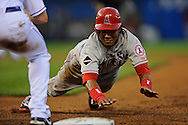 July 22, 2009:  Base runner Erick Aybar #2 of the Los Angeles Angels dives back safely to first base during the fourth inning against the Kansas City Royals at Kauffman Stadium in Kansas City, Missouri.  ..