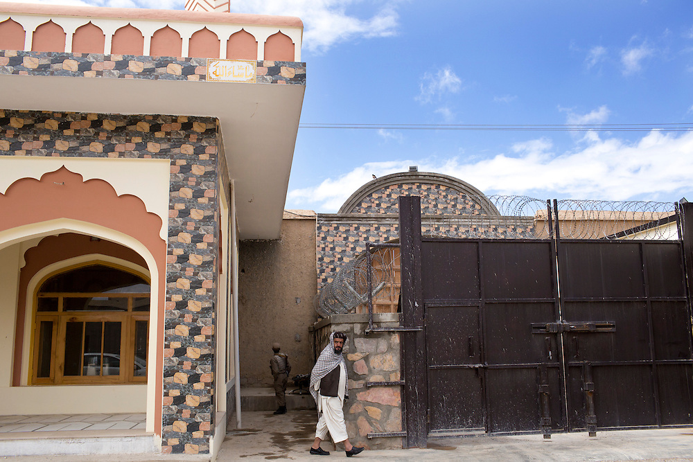 March 23, 2014 - Kandahar, Afghanistan - Hashmat Karzai, cousin of Afghan President Hamid Karzai at his home in their historic village of Karz near Kandahar, Afghanistan. <br /> A number of heavy gates protect the entrance to the fortress-like compound.
