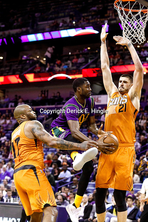Feb 6, 2017; New Orleans, LA, USA; New Orleans Pelicans guard E'Twaun Moore (55) drives to the basket past Phoenix Suns center Alex Len (21) and forward P.J. Tucker (17) during the second quarter of a game at the Smoothie King Center. Mandatory Credit: Derick E. Hingle-USA TODAY Sports