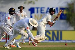 July 26, 2017 - Galle, Sri Lanka - Indian cricketer Cheteshwar Pujara(R) plays a shot during the 1st Day's play in the 1st Test match between Sri Lanka and India at the Galle International cricket stadium, Galle, Sri Lanka on Wednesday 26 July 2017. (Credit Image: © Tharaka Basnayaka/NurPhoto via ZUMA Press)