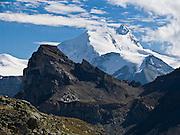 "The sharp peak of Weisshorn (""White Peak"") rises to 4506 meters or 14,783 feet elevation in the Pennine Alps, Switzerland, on the High Route (Chamonix-Zermatt Haute Route), Europe."