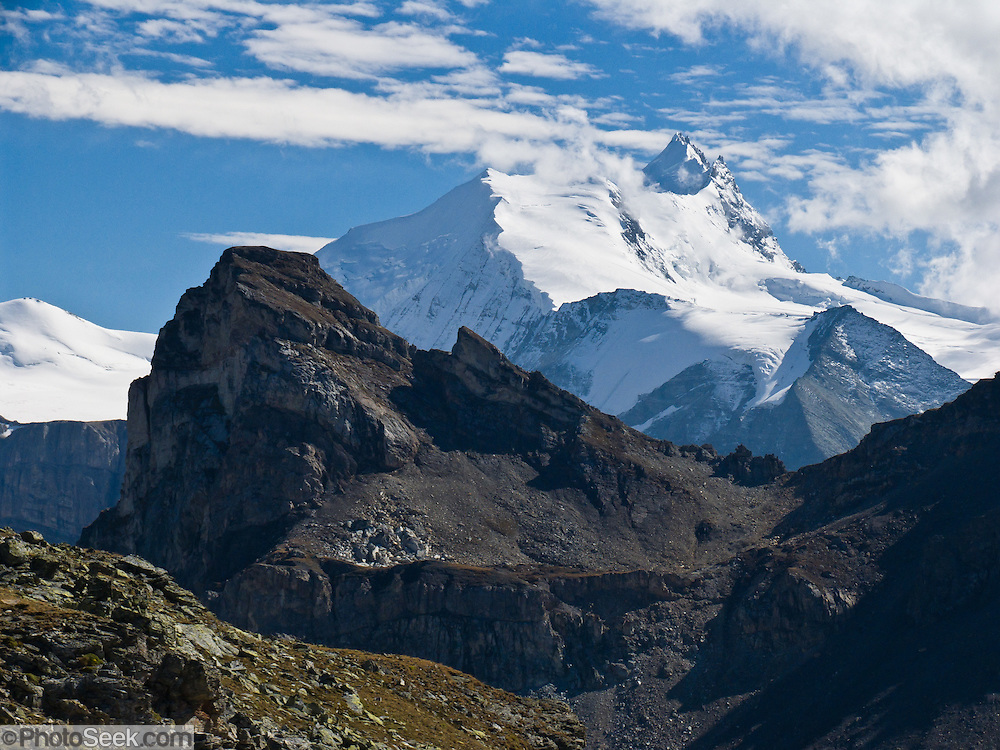 "The sharp peak of Weisshorn (""White Peak"") rises to 4506 meters or 14,783 feet elevation in the Pennine Alps, Switzerland, on the High Route (Chamonix-Zermatt Haute Route), Europe."