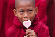 Young Monk with heart shaped candy, Ananda Temple Festival, Bagan