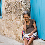 Cuban woman sleeping in a doorway in Old Havana