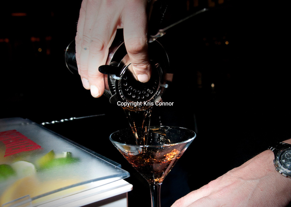 A bartender pours a Martini at The Passenger in Washington DC.