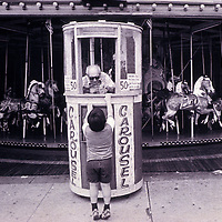 A child buys a ticket to ride the carousel at Coney Island in Brooklyn, New York in 1978. No release
