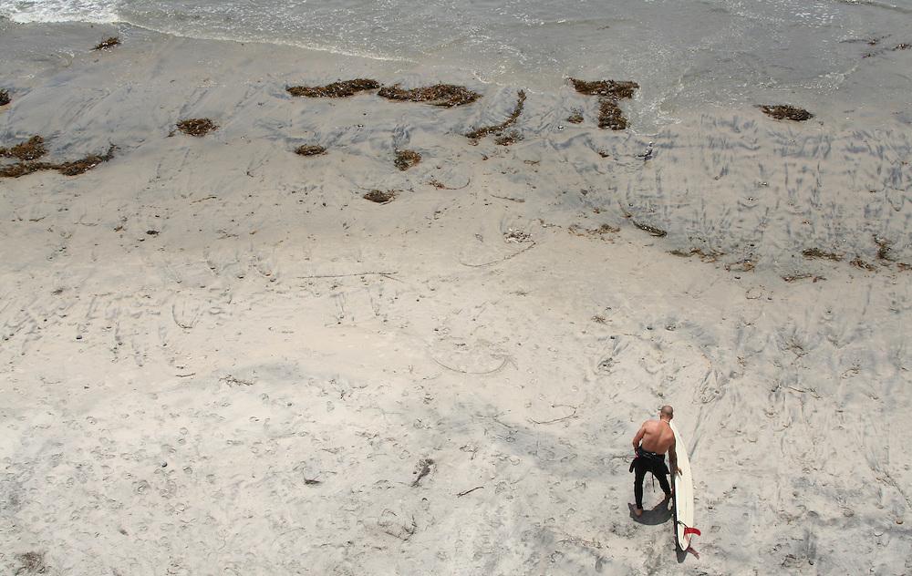 Surfer at Swami's Beach in Encinitas, California