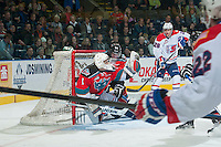 KELOWNA, CANADA - NOVEMBER 7: Jackson Whistle #1 of Kelowna Rockets makes a save as Joe Gatenby #28 of Kelowna Rockets checks a player of the Spokane Chiefs into his net on November 7, 2014 at Prospera Place in Kelowna, British Columbia, Canada.  (Photo by Marissa Baecker/Shoot the Breeze)  *** Local Caption *** Joe Gatenby; Jackson Whistle;