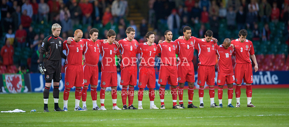 CARDIFF, WALES - Wednesday, April 1, 2009: Wales' players stand for a minute's silence as a mark of respect for the African football family and in memory of the persons who lost their lives outside of the stadium in Abidjan, Cote d'Ivoire on 29 March 2009, ahead of the match between Cote d'Ivoire and Malawi, during the 2010 FIFA World Cup Qualifying Group 4 match at the Millennium Stadium. (Pic by David Rawcliffe/Propaganda)